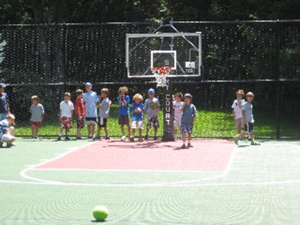Basketball by Sport Court, the kids love the adjustable hoop